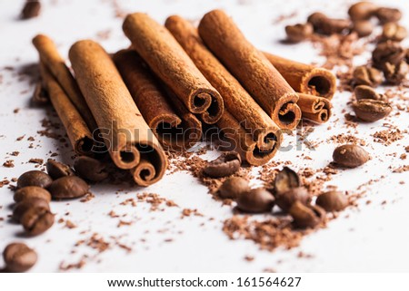 Close up of cinnamon sticks, coffe beans and particles of chocolate  - stock photo
