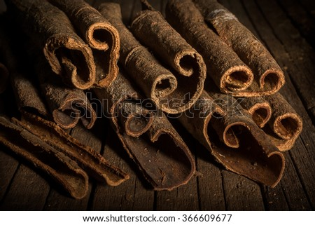 Close up of cinnamon sticks on wooden background - stock photo