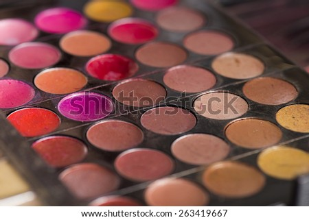 Close Up of Circular Colorful Lip Glosses and Shadows in Make Up Palette - stock photo