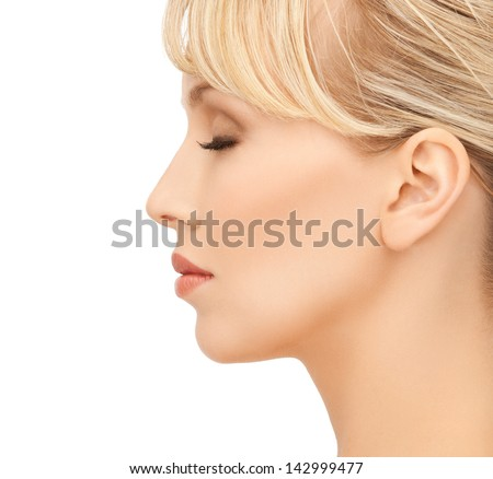 close up of clean face of beautiful young woman - stock photo