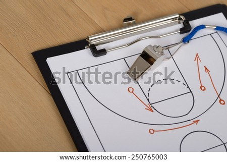 Close-up Of Clipboard With Whistle And Sport Tactics On Paper - stock photo