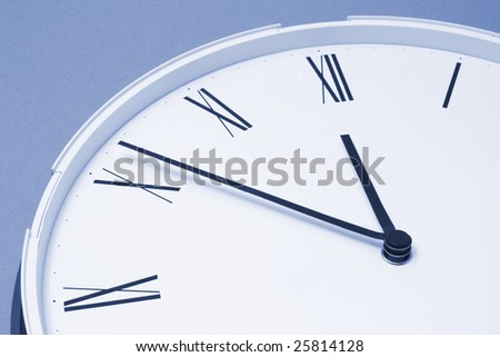 Close Up of Clock Face in Blue tone - stock photo
