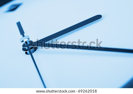 Close-up of clock hands. Toned in blue - stock photo