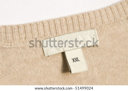 close-up of clothing label with xxl size - stock photo