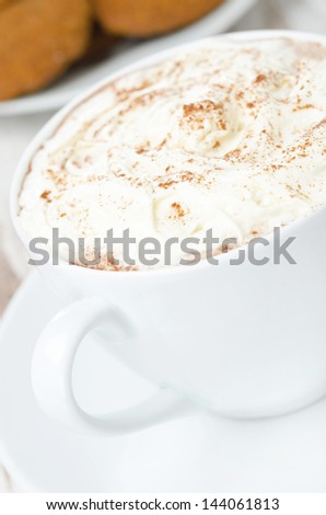 close-up of cocoa with cinnamon and whipped cream, selective focus, vertical - stock photo