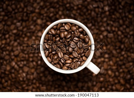 Close up of coffee beans in the coffee cup - stock photo