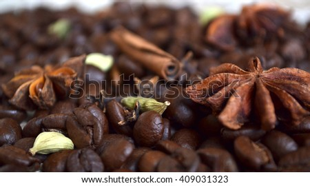 Close up of coffee beans with flavoring : cardamom, cinnamon,?carnation, star anise. Coffee concept. star anise  star anise cinnamon cinnamon - stock photo