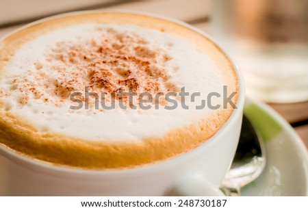 Close-up of Coffee,Cappuccino coffee cup,backlight - stock photo