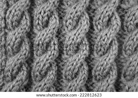 Close up of coiled rope cable knitting stitch - monochrome processing - stock photo
