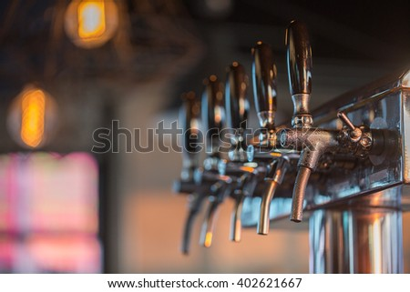 Close Up of Cold Beer Tap (Selective Focus Point) - stock photo
