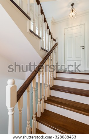 Close up of colonial designed staircase, vertical - stock photo