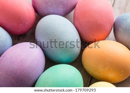 close up of colored Easter eggs on wood background - stock photo