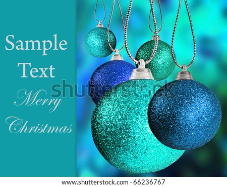 Close up of colorful blue christmas bauble balls in different sizes  hanging on strings - stock photo