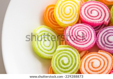 Close-up of colorful candy on the plate - stock photo