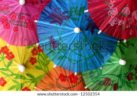 Close up of colorful cocktail umbrellas perfect for background - stock photo