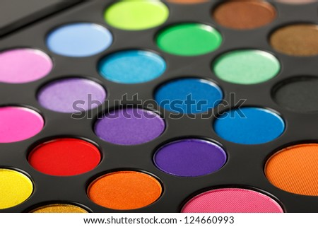 Close-up of colorful eyeshadow palette. - stock photo