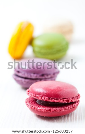 Close-up of colorful macaroons on light background - stock photo