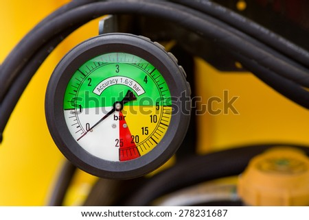 Close up of colorful manometer on agricultural machinery  - stock photo