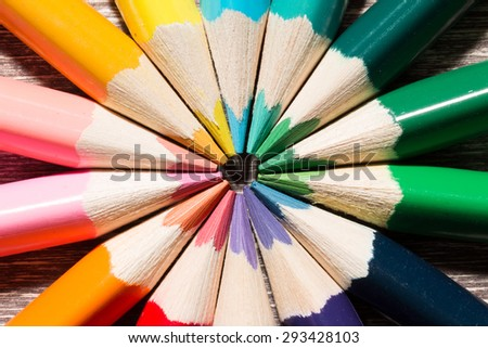 Close up of Colorful Pencils On Wooden Background. - stock photo