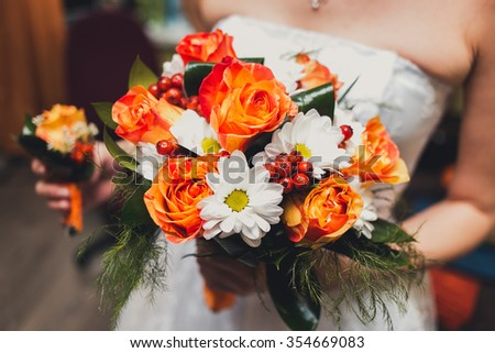 close-up of colorful wedding bouquet at bride's hands. - stock photo