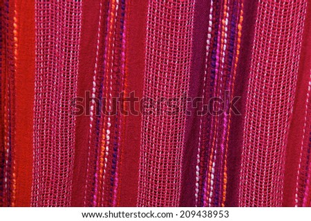 Close up of colorful woven fabric fills the image - stock photo
