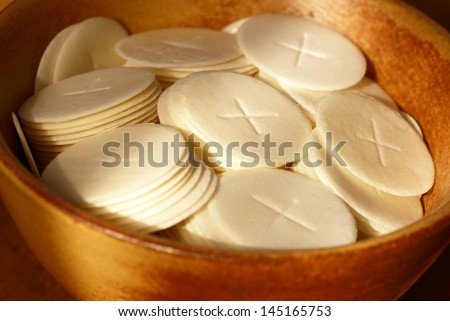 Close-up of communion wafers in a bowl - stock photo