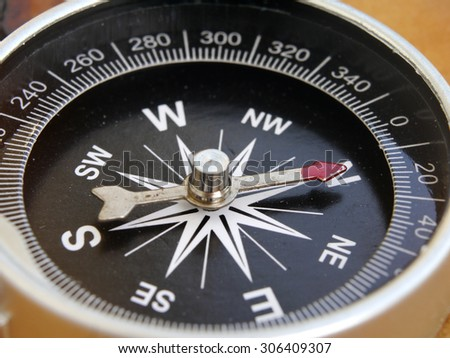 close up of compass - stock photo