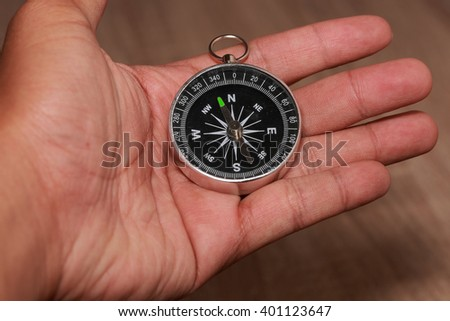 Close up of Compass and point to North. - stock photo