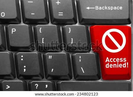 Close-up of Computer keyboard, with red key of Access denied - stock photo