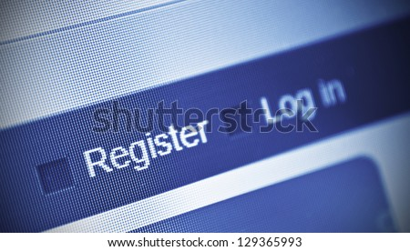 close-up of computer screen and register button - stock photo