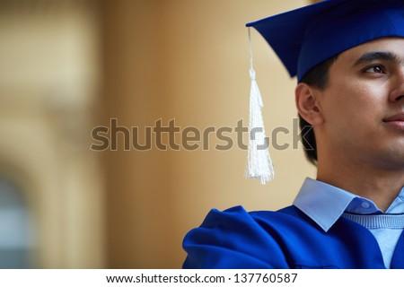 Close-up of confident graduation student - stock photo