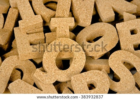 close up of cork block letters in a pile - stock photo