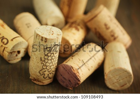 Close up of cork wine on a wooden table - stock photo