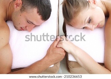 Close up of couple in love;profile of woman and man holding hands  - stock photo