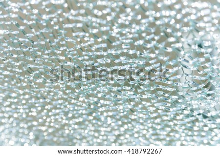 Close-up of cracked glass Blasted safety glass - stock photo