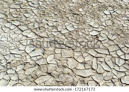 Close-up of cracked soil ground in the dry season - stock photo
