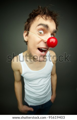 Close-up of crazy guy smiling at camera on fool�s day - stock photo