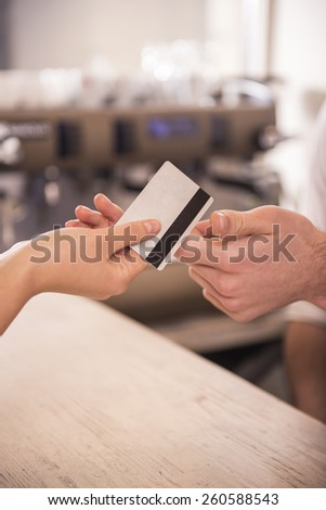 Close-up of credit card in humans hand. - stock photo