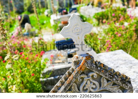 Close up of cross in an old Cemetery - stock photo