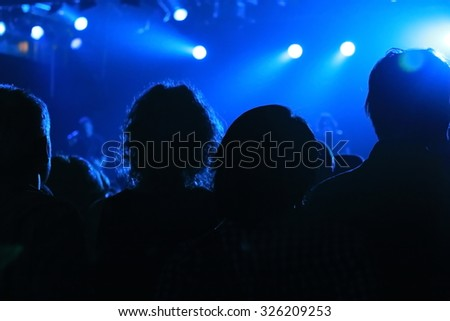 Close up of crowd enjoying the concert in one of the rock show - stock photo