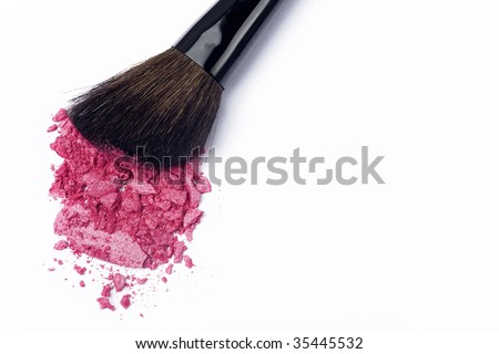 Close up of crushed blush on white background and cosmetic brush - stock photo