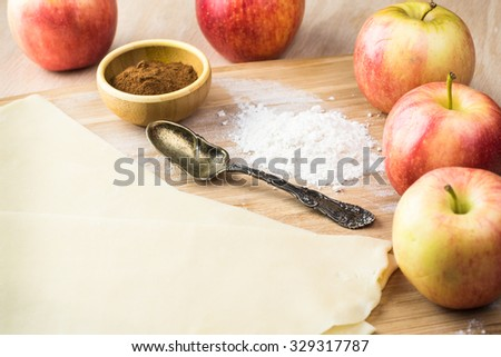 Close up of crust for apple roses pie and fresh apples. - stock photo