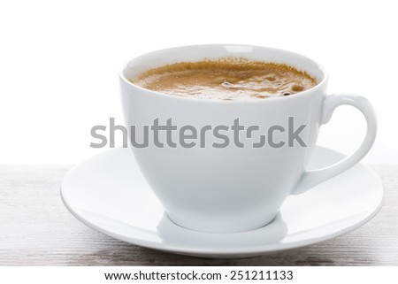 close-up of cup of coffee on a white table, close-up - stock photo