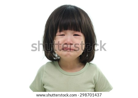 Close up of cute asian child crying on white background isolated - stock photo