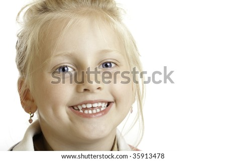 close-up of cute innocent girl which smiles happy into camera - stock photo