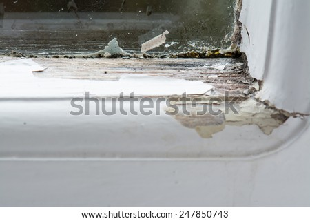 Close up of damage to wooden single glazed window caused by condensation and rain - stock photo