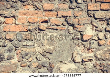 Close up of  Dark and old stone wall - stock photo