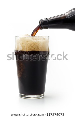 close up of dark beer poured from the bottle - stock photo