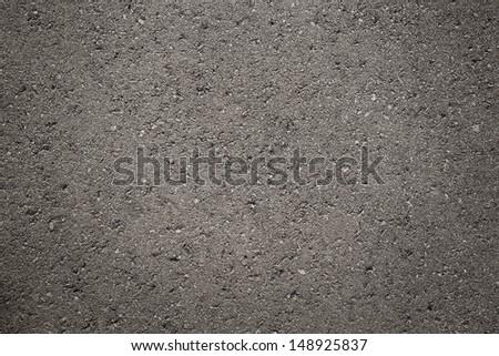 Close up of dark, grunge asphalt, concrete texture with copy space - stock photo