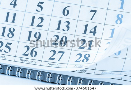 Close up of dates on calendar page - stock photo
